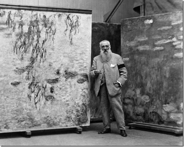 Monet and his Waterlilies in his studio (1923-24).jpg